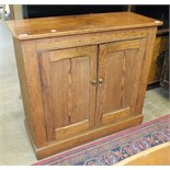 A pitch pine two-door side cupboard on plinth base, 97cm wide, 87cm high.
