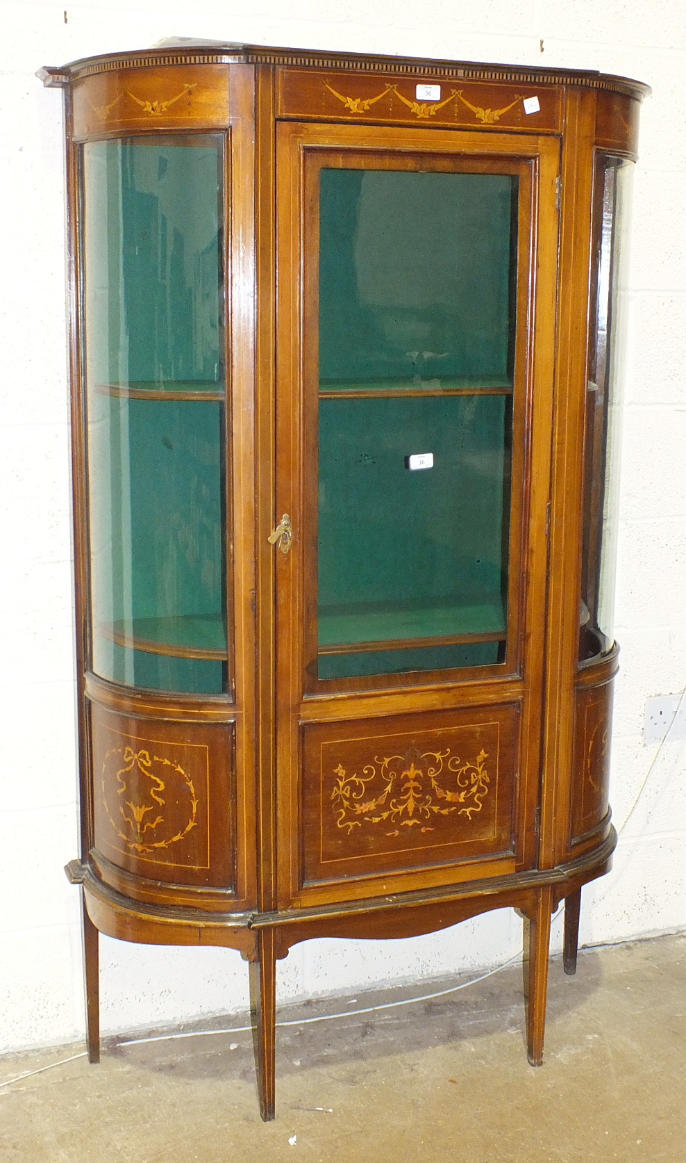 An Edwardian inlaid mahogany display cabinet with bowed glazed sides and door, 106cm wide, 172cm