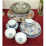 A group of Oriental porcelain items, to include: A Canton bowl, Imari charger, Imari dishes and