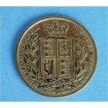An 1851 Victoria (young head) sovereign.