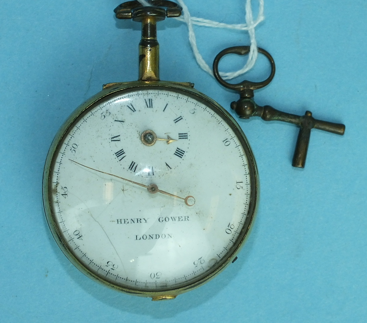 Lot 156 - An 18th century open-face pocket watch by Henry Gower, London, the white enamel dial with subsidiary