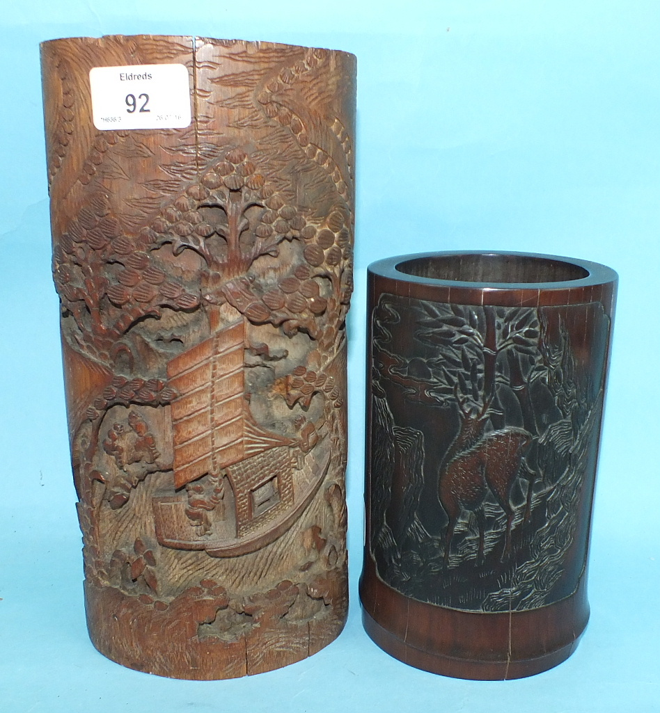 A Chinese bamboo brush pot carved with calligraphy and deer and a larger example carved with figures