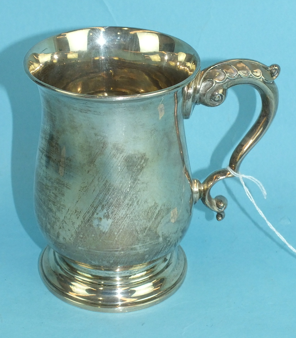 Lot 443 - A silver tankard of plain form with stylised dolphin handle, 13cm high, Birmingham 1939, ___9½oz.