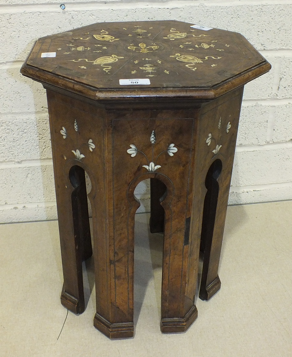 An Oriental walnut octagonal small table inlaid with white metal lines and ivory detail, 48cm