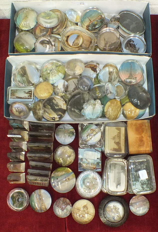 A large group of 19th and 20th century glass souvenir paperweights, approximately 100.