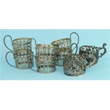 Six silver pierced decorated coffee can holders, 4cm high overall, Birmingham 1922 and two others