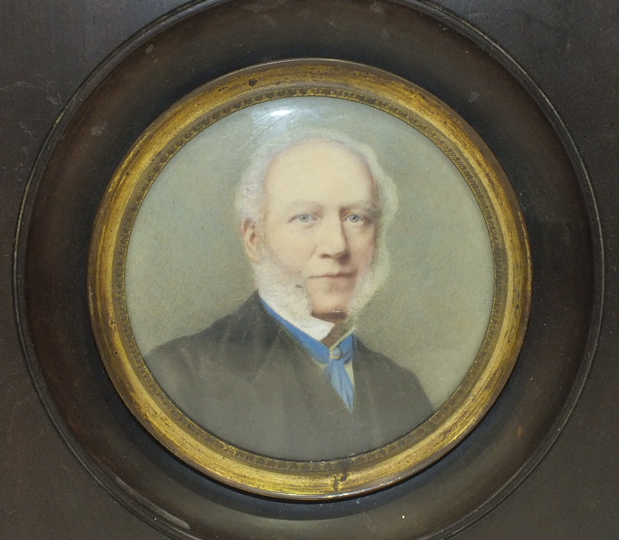 A late-Victorian/Edwardian miniature study of a gentleman 'Mr Riply, Bradford', in circular wooden