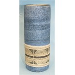 A Troika Pottery small cylindrical-shaped vase decorated with a geometrical pattern within bands, on
