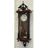 A Vienna-style stained wood wall clock with gong-striking twin-trained movement and two-piece