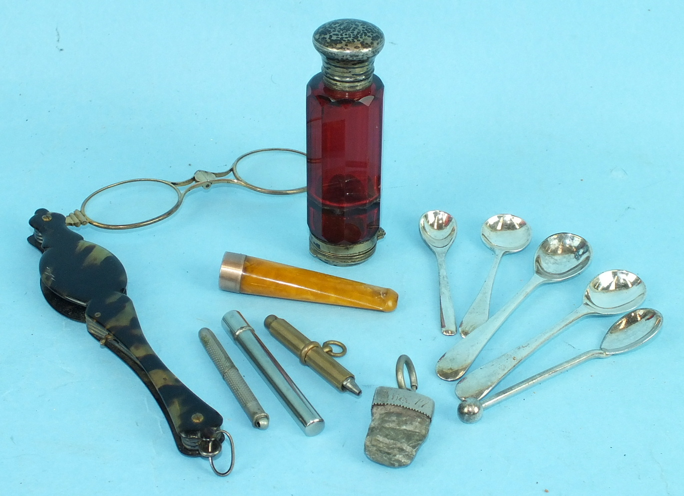 A 19th century ruby glass double-ended scent bottle, a pair of tortoiseshell-cased gilt lorgnettes