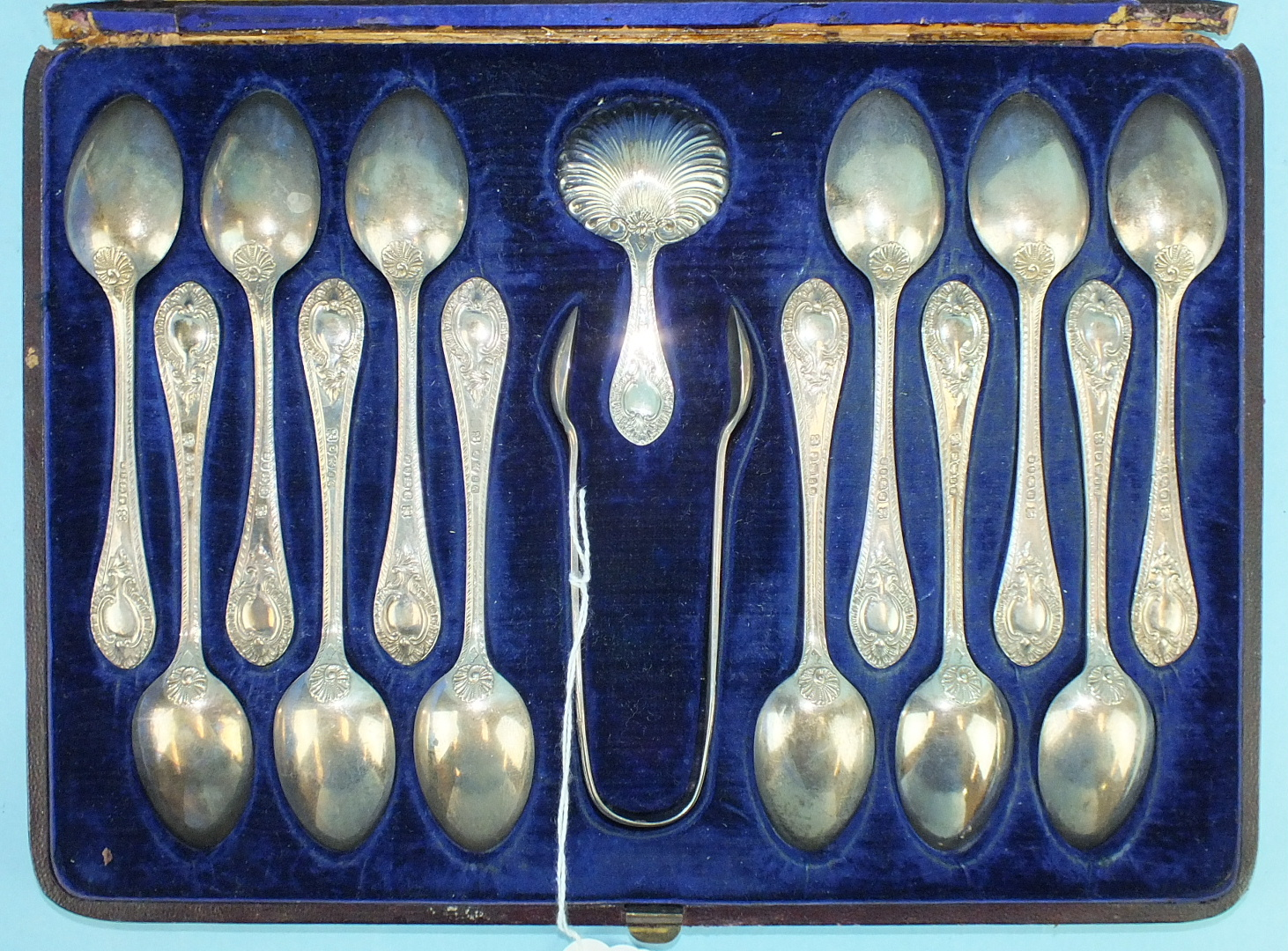 Lot 422 - A cased set of twelve silver teaspoons, sugar tongs, Sheffield 1873 and similar caddy spoon with