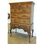 An 18th century walnut chest on stand, the moulded cornice above an arrangement of six banded