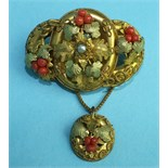 A Victorian gilt brooch of three hoops overlaid with vine leaves, coral fruit and cannetile