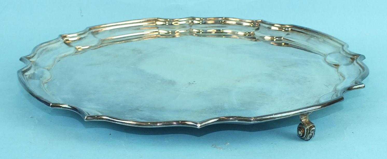 Lot 420 - A modern silver Chippendale-style salver on three scroll feet, London 1967, 30.5cm diameter, ___23½