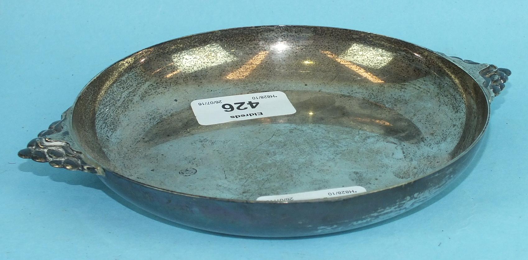Lot 426 - A silver circular two-handled shallow dish, 18cm, Sheffield 1945, ___8oz.