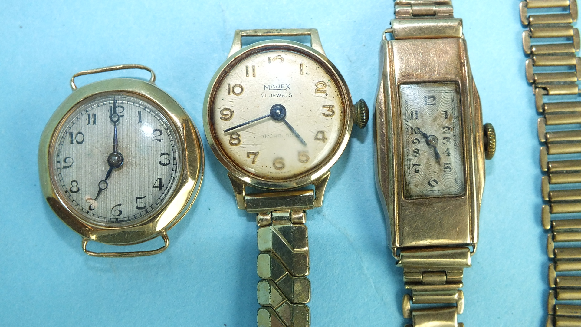 Lot 150 - Three ladies 9ct-gold-cased wrist watches, one on 9ct gold bracelet, (14g), (3).