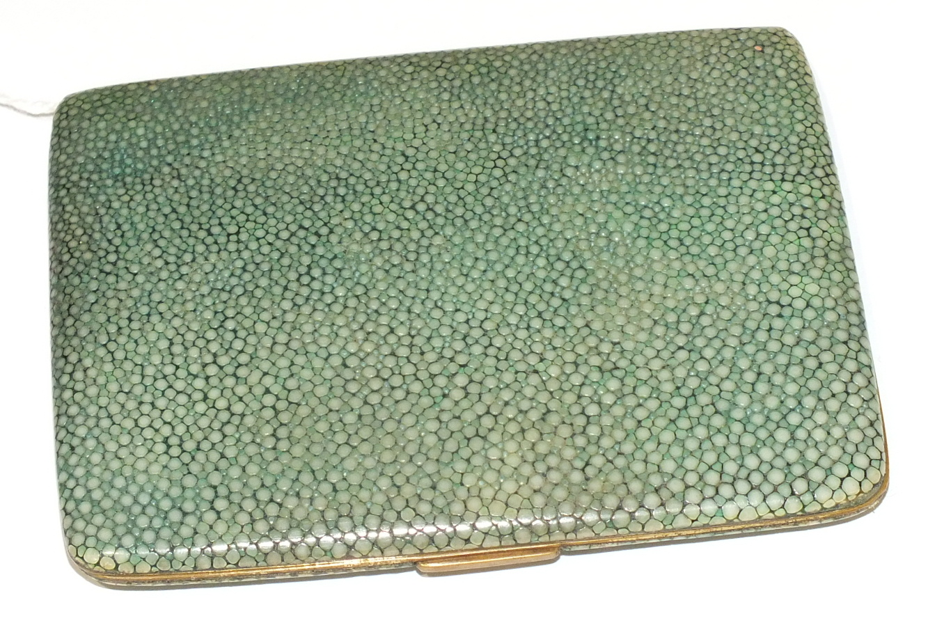 Lot 58 - A gilt metal and shagreen-covered cigarette case of rectangular form, stamped 'Aristocrat, Made in