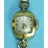 Omega, a ladies gold wrist watch with 18ct gold case and 9ct gold bracelet, 16g.