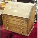 A collectors' chest in the form of a small pine bureau, the fall front above four long drawers, 44.