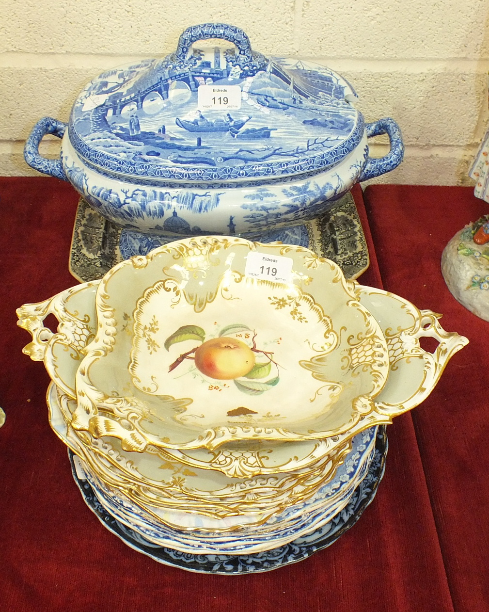 An early-19th century Spode transfer-printed pottery soup tureen and cover, various printed plates