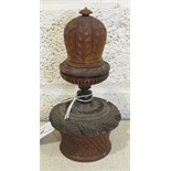 A large carved coquilla nut nutmeg grater in the form of a mitre, on nutmeg storage box in the