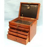 A similar dentist's cabinet, the lift lid with leather wallet marked 'Cash, Sons & Co, London',