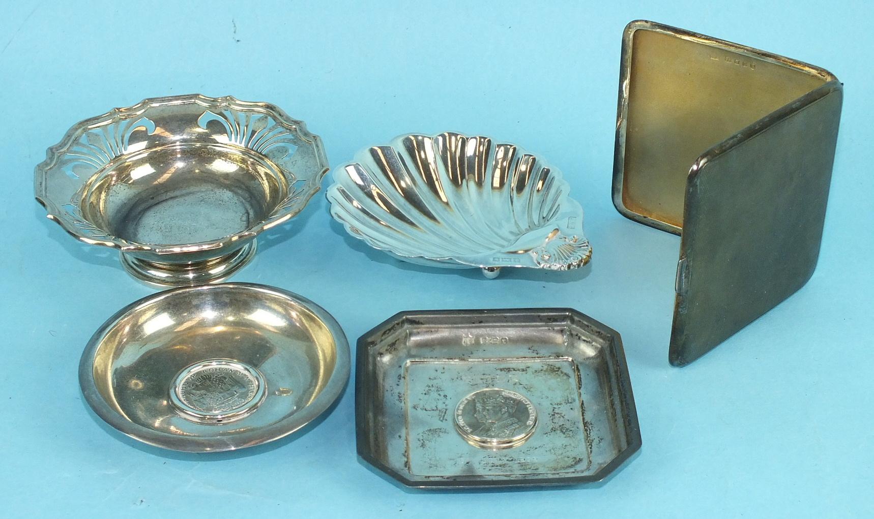 Lot 469 - A silver cigarette case, 8cm square, London 1935, a modern silver shell-shaped dish, 10cm, 1971, a