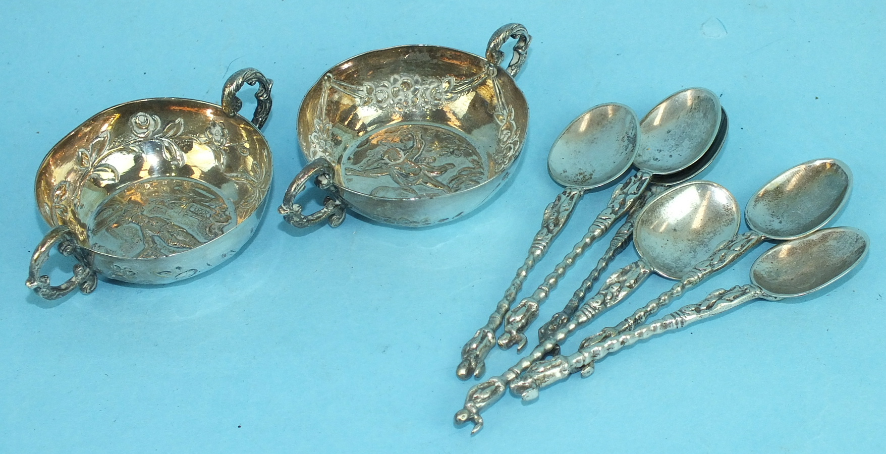 Lot 391 - A pair of Continental two-handled embossed salts with import marks and a set of six coffee spoons.