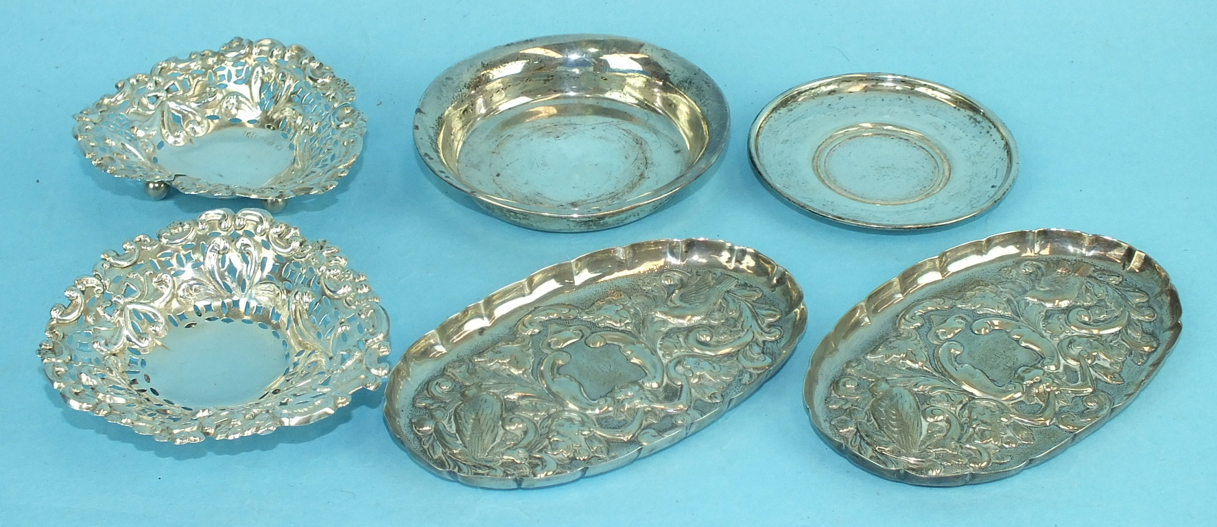 Lot 457 - A pair of Victorian oval embossed pin trays decorated with birds and foliage, London 1894 and