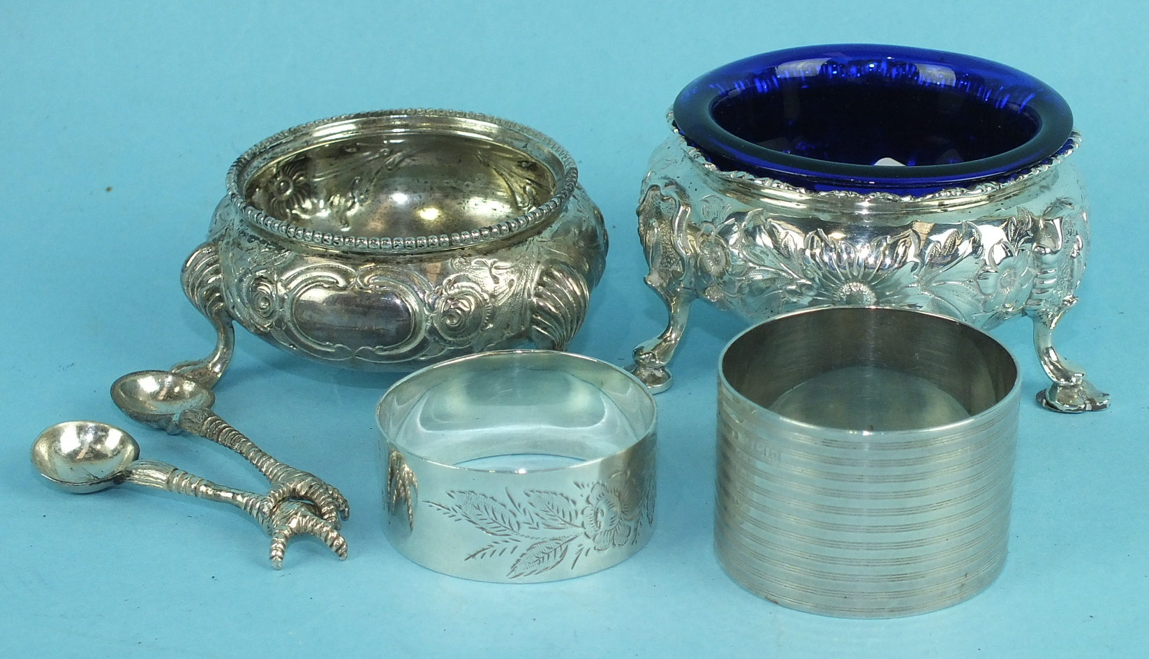Lot 452 - A Victorian silver salt with embossed floral decoration, on three hooved feet, 8cm diameter.
