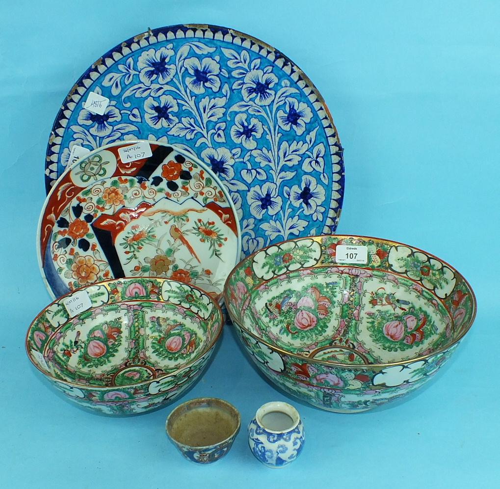 A 19th century Iznik dish, an Imari dish and other Oriental ceramics, (6 pieces).