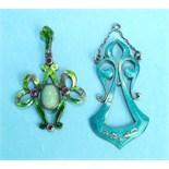 An Art Nouveau green-enamelled white metal pendant of open bow form, collet-set a jade cabochon