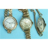 Three ladies 9ct-gold-cased wrist watches on plated bracelets, (3).