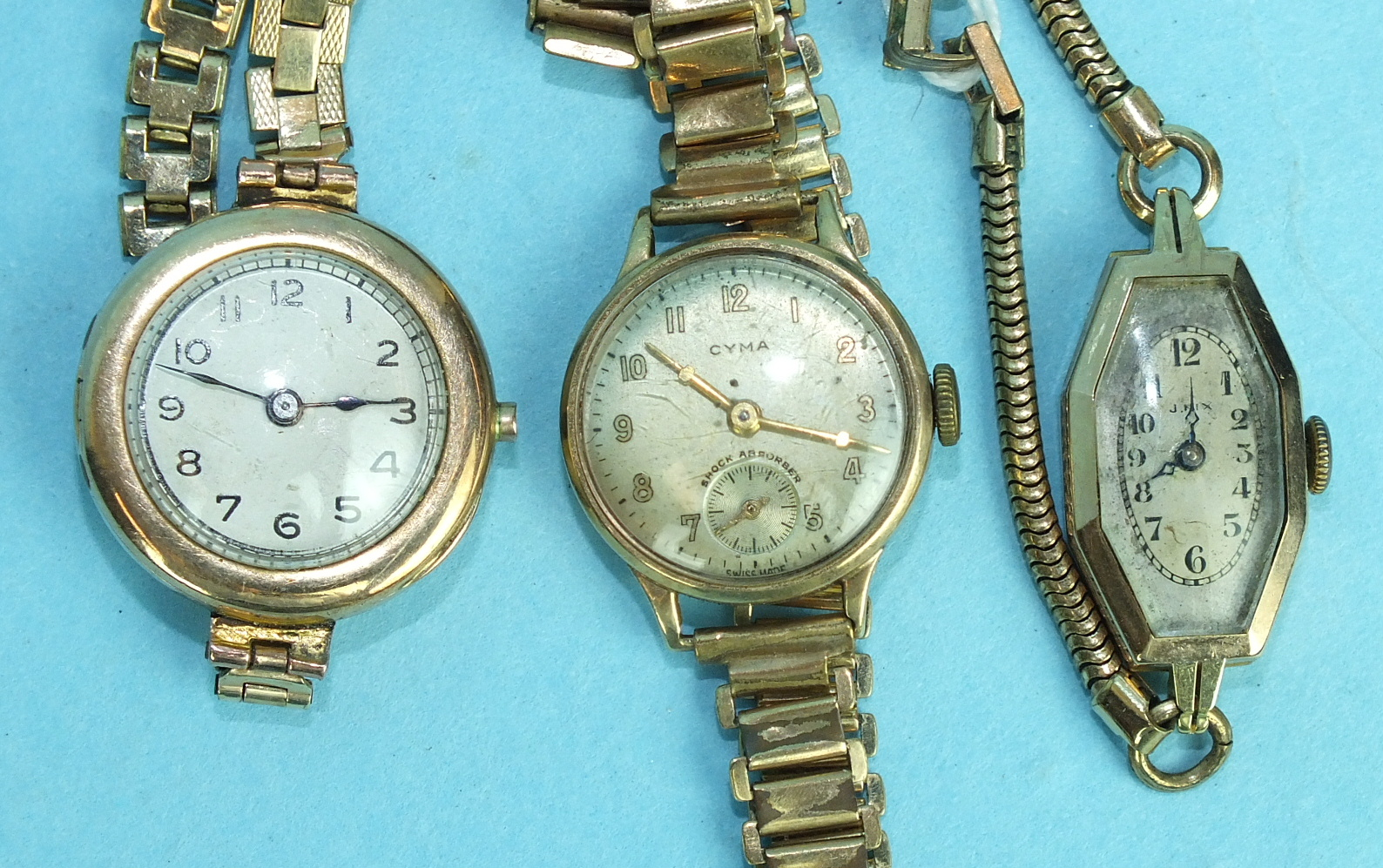 Lot 155 - Three ladies 9ct-gold-cased wrist watches on plated bracelets, (3).