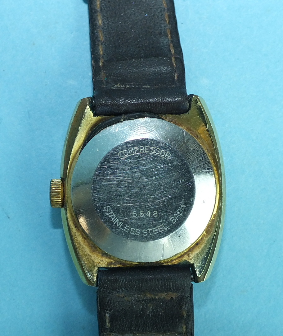 Lot 148 - A ladies Watches of Switzerland Seafarer automatic wrist watch, the round gold face with baton