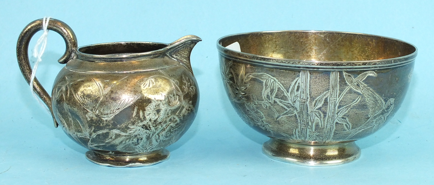Lot 432 - A silver sugar bowl with etched decoration of birds among bamboo and other foliage, London 1880,