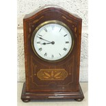 A late-Victorian inlaid mahogany mantel clock with circular enamel dial and key-wind drum
