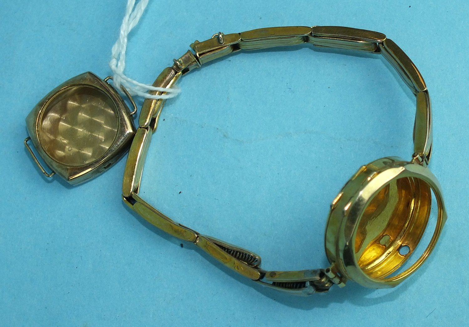 Lot 309 - A 9ct gold watch case and expanding bracelet and a 9ct gold watch case, total weight 9.8g, (2).