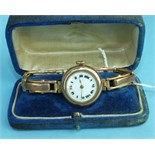A ladies 9ct-gold-cased wrist watch with gold expanding bracelet, total weight 28.6g, boxed.