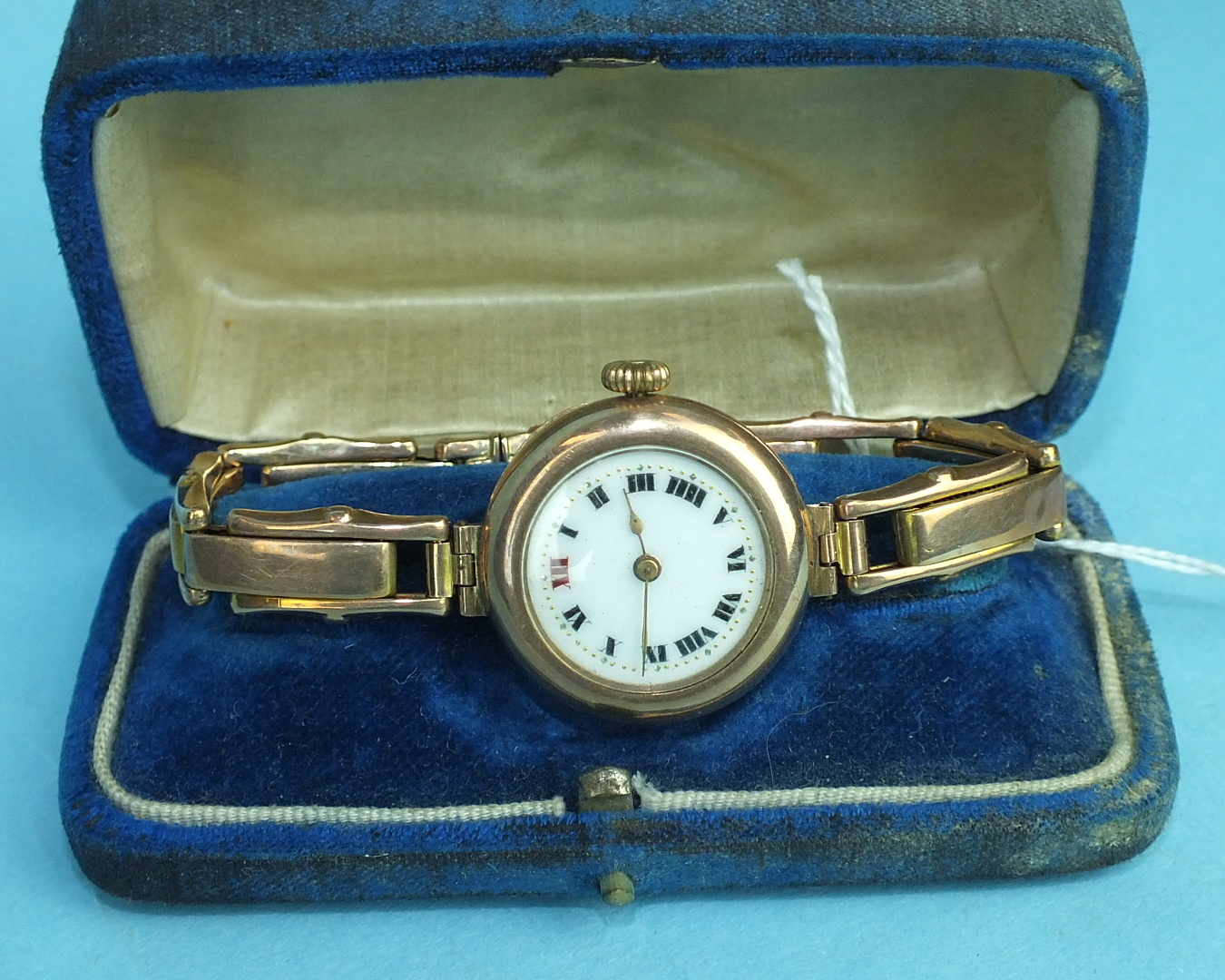 Lot 145 - A ladies 9ct-gold-cased wrist watch with gold expanding bracelet, total weight 28.6g, boxed.