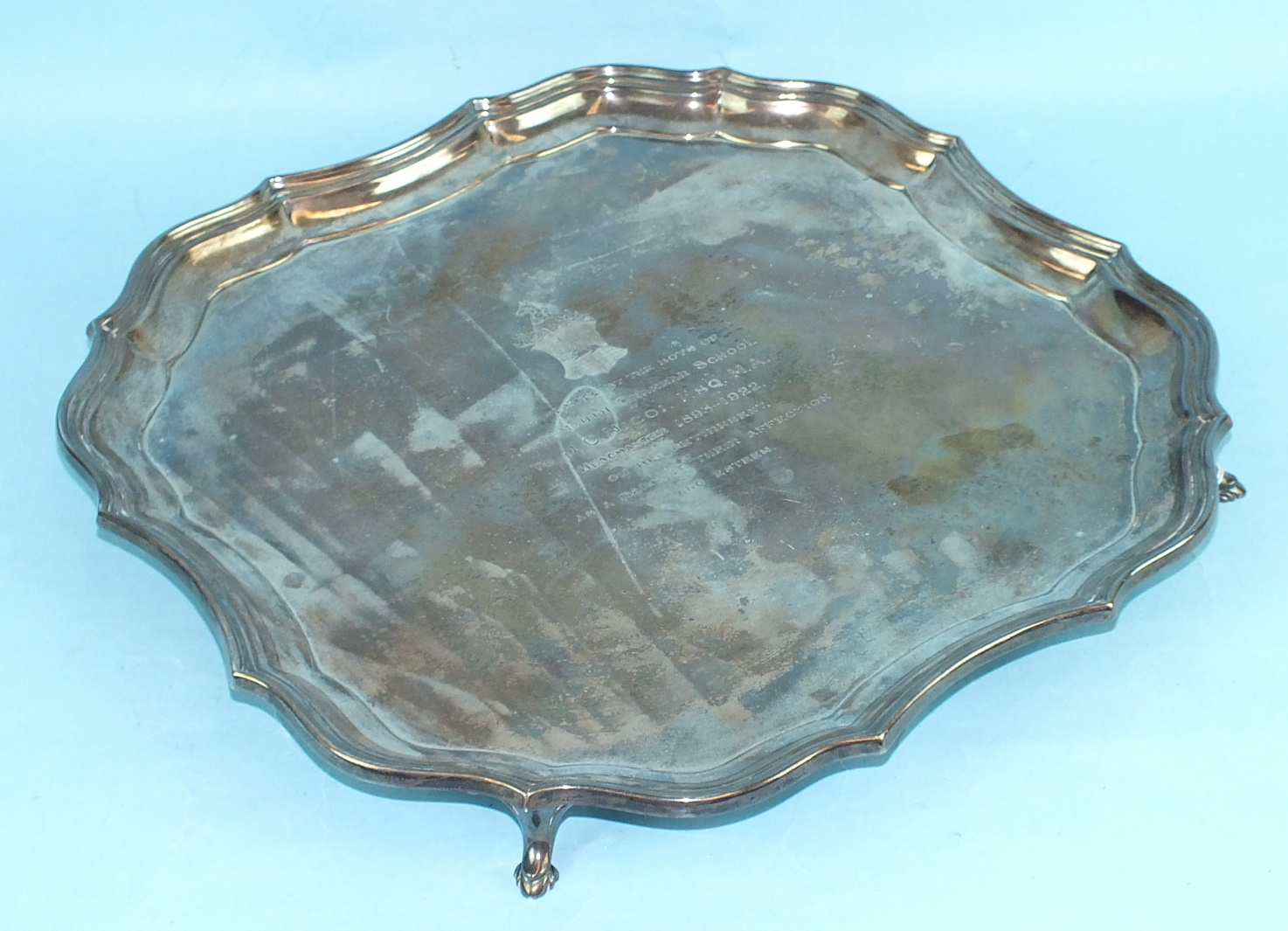 Lot 442 - A silver square Chippendale-style salver of four hoofed feet, 35.5cm, engraved inscription to top,