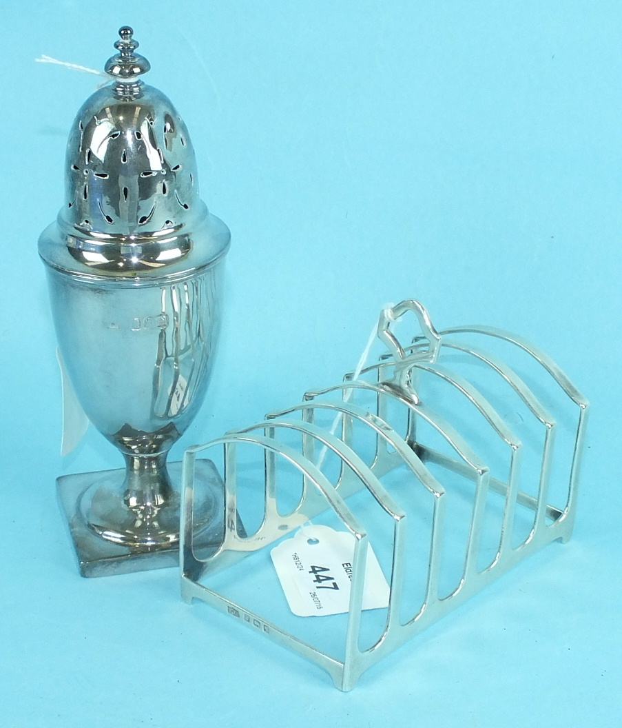 Lot 447 - A Mappin & Webb silver six-section toast rack, 9.5cm high overall, 11cm long, Birmingham 1915 and