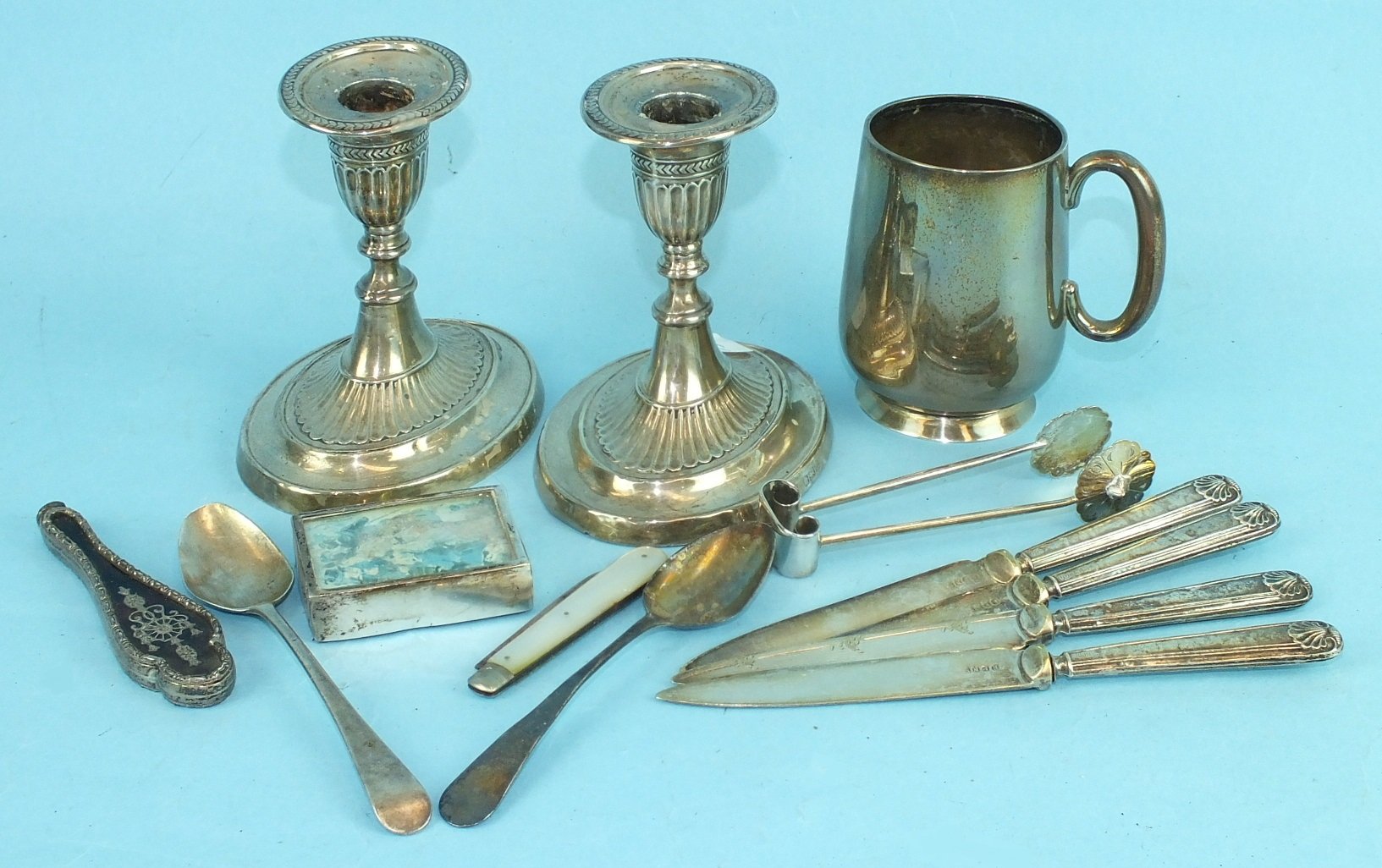 Lot 424 - A pair of short silver candlesticks of gadrooned form, on loaded oval bases, Sheffield 1904, 11cm