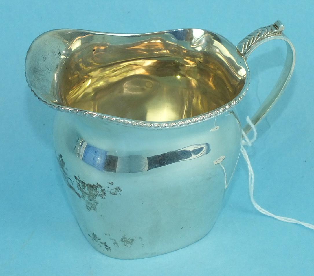 Lot 445 - A silver cream jug of plain form, with beaded rim, 7.8cm high, Birmingham 1937, ___3oz.