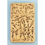 A 19th century Chinese ivory card case deeply-carved with figures in rural pursuits and garden