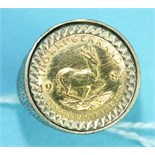 A 1984 1/10 Krugerrand coin mounted in a 9ct gold ring, size N, 7.6g.