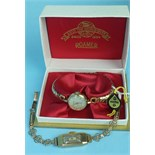 A ladies 'Crusader' 9ct-gold-cased wrist watch on gold bracelet, 13.6g and a ladies Roamer wrist