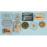 A group of ten advertising glass paperweights, including examples for 'Bell's Asbestos', 'Hay's