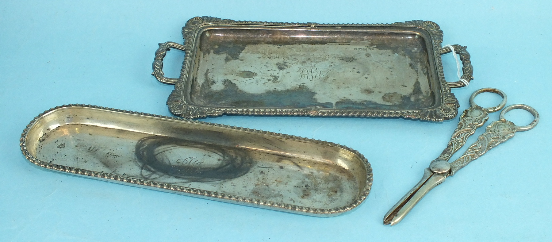 Lot 431 - A small silver two-handled rectangular tray with embossed decorated border, Sheffield 1900, 22 x