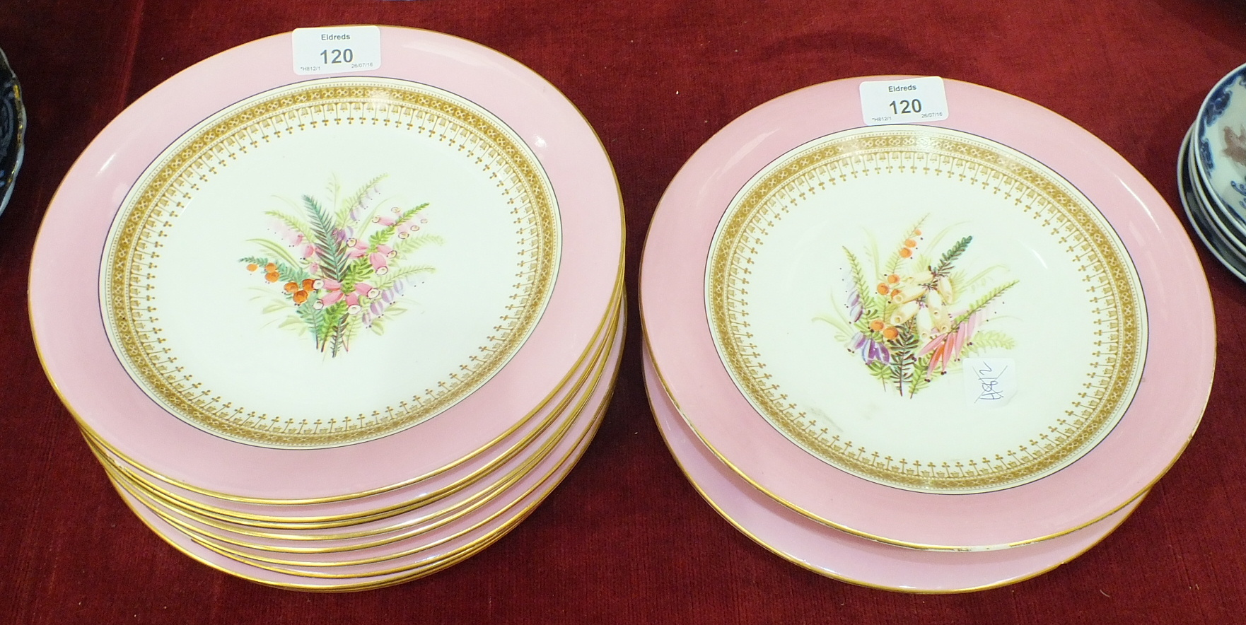 A Royal Worcester porcelain part dessert service decorated with a spray of summer flowers within a